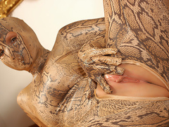 Awesome snake girl Mimmi spreads her juicy pussy