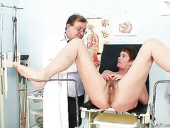 Old hairy twat gets inspected with bizzare spreader