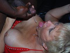 Blonde mature eats big black cock and swallows cum