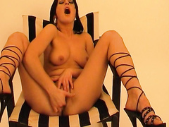 Juicy babe Nadja spreads legs and masturbates twat