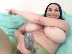 Sexy MILF with giant boobs and extra large dildo