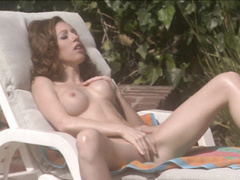 Dildo helps horny babe to feel good by the poolside