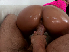 Exotic babe Jynx Maze shakes her oiled butt while riding dick in reverse pose