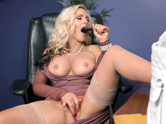 Alena Croft nude is in her clothes in this video in office