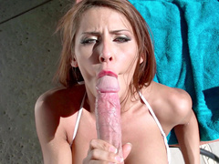 Stepmom Madison Ivy with red hair gently sucks stepson by poolside