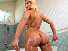 Natural blonde Anikka Albrite shakes her sexy booty in the bathroom