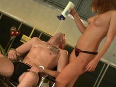 Superb babe puts a lotion on man